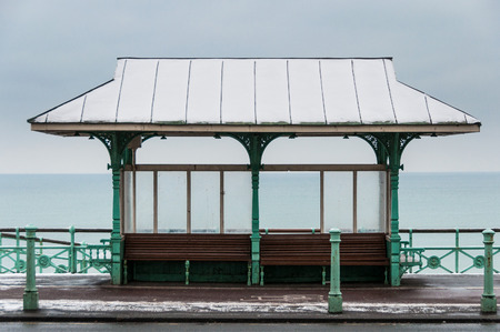 Benches on Brighton sea front in winter photo