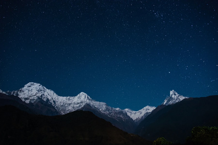The Annapurna massif at night, view from Ghandruk, Nepal photo
