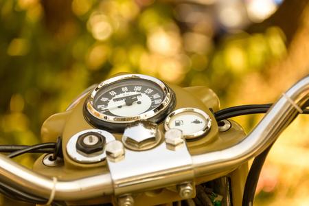 handlebars: Vintage khaki motorcycle dashboard close-up Stock Photo