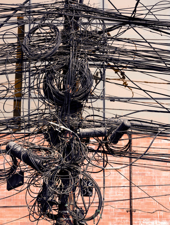 messed up: Electric wires on a post in Kathmandu, Nepal