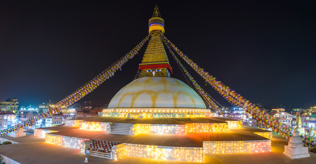hemispherical: Boudhanath stupa illuminated for Losar, the Tibetan new year, Kathmandu, Nepal