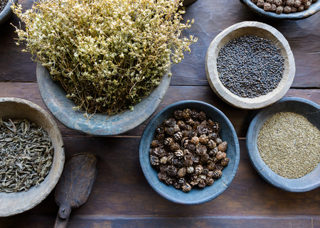 Herbs and spices in bowls used in ayurvedic medicine photo