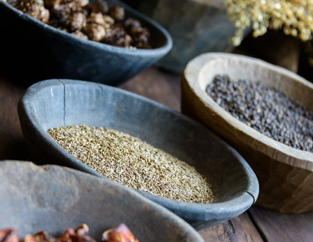 dried herb: Herbs and spices in bowls used in ayurvedic medicine