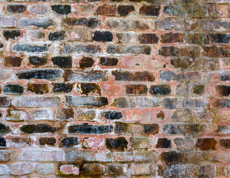 Stained old brick wall texture photo