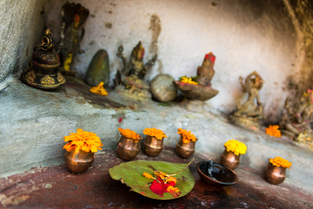hinduist: Small hinduist temple with french marigolds
