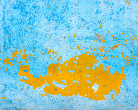 Blue and orange grungy wall texture photo