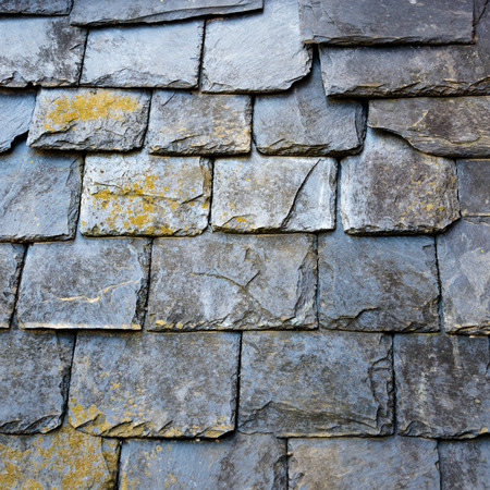 Slate roof detail, some of the slates covered by lichen