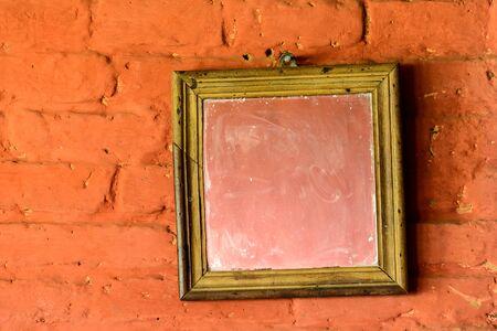 wall mirror: Square mirror on a brick wall
