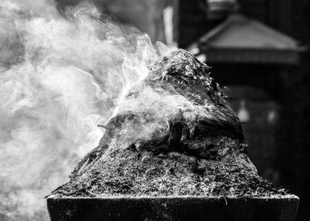 black worship: Encens burning in Kathmandu, Nepal  Black and white
