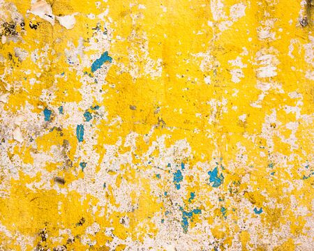 Grungy yellow wall texture photo