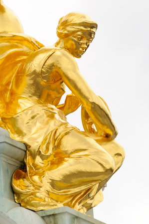 buckingham palace: Gold statues on top of the Queen Victoria Memorial in London