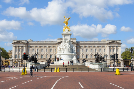 buckingham palace: LONDON, UK - CIRCA May 2012  The Queen Victoria Memorial and Buckingham Palace by a sunny day