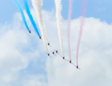 aerobatics: LONDON, UK - CIRCA JUNE 2012  The Red Arrows are doing a flypast over Buckingham Palace