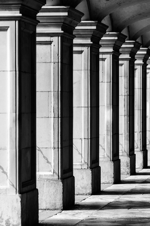 recedes: Square columns in black and white Stock Photo