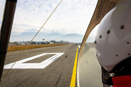 Ultralight ready for takeoff at Pokhara airport, Nepal photo