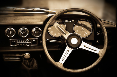 steering: Vintage car dashboard, sepia toning Stock Photo