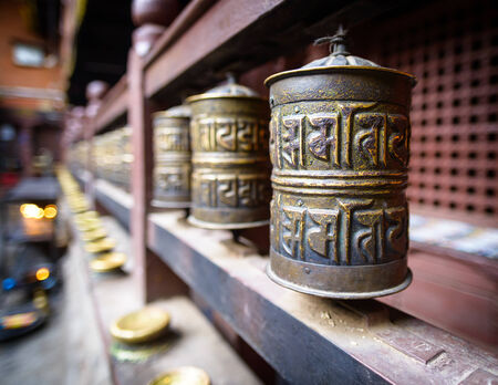 Prayer wheels in a monastery in Kathmandu, Nepal photo