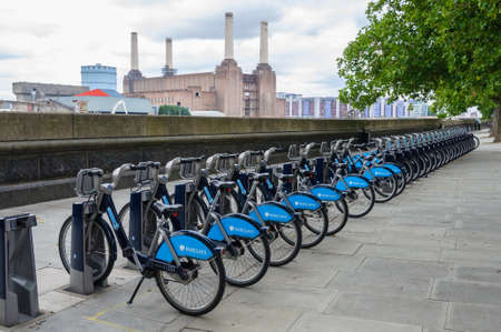 rack wheel: LONDON, UK - CIRCA JULY 2011: Barclays Cycle Hire station opposite Battersea power station. Barclays Cycle Hire is a public bicycle sharing scheme launched on July 30, 2010.