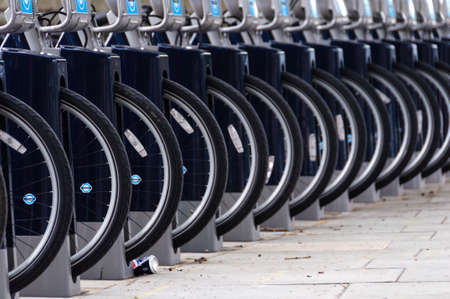 rack wheel: LONDON, UK - CIRCA JULY 2011: Detail of a Barclays Cycle Hire station. Barclays Cycle Hire is a public bicycle sharing scheme launched on July 30, 2010.