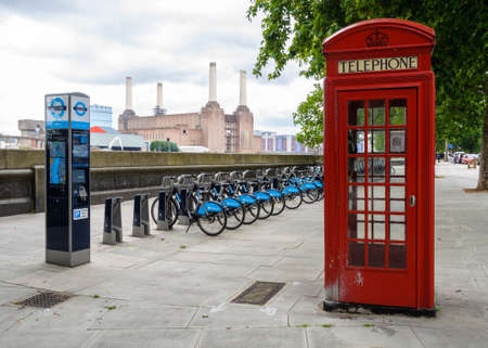 LONDON, UK - CIRCA JULY 2011: Barclays Cycle Hire station opposite Battersea power station. Barclays Cycle Hire is a public bicycle sharing scheme launched on July 30, 2010.