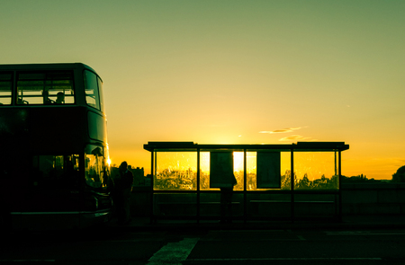 Bus stop at sunset in London, UK photo
