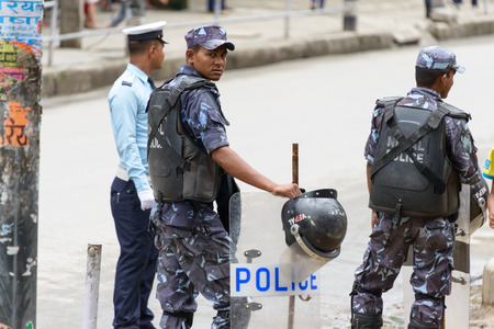 KATHMANDU, NEPAL - AUGUST 3, 2014  Policemen on the way Indian Prime Minister Narendra Modi will take when he arrives in Kathmandu on a 2-day official Nepal visit
