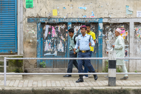 KATHMANDU, NEPAL - AUGUST 3, 2014  Police officer and pedestrians on the way Indian Prime Minister Narendra Modi will take when he arrives in Kathmandu on a 2-day official Nepal visit