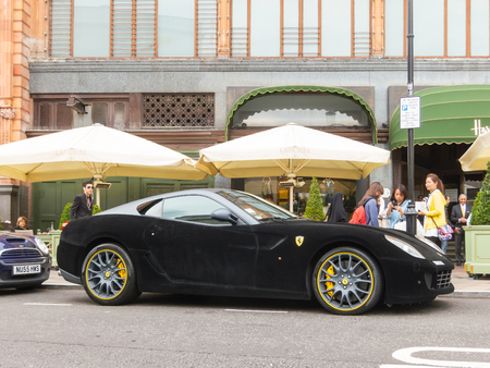 ferrari: LONDON, UK - CIRCA AUGUST 2013: A Ferrari 599 GTB Fiorano with a black velvet wrap.
