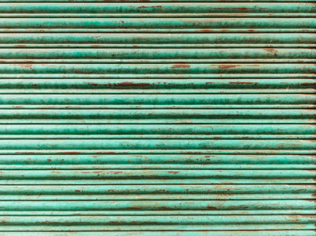 Green and rusty iron curtain texture photo