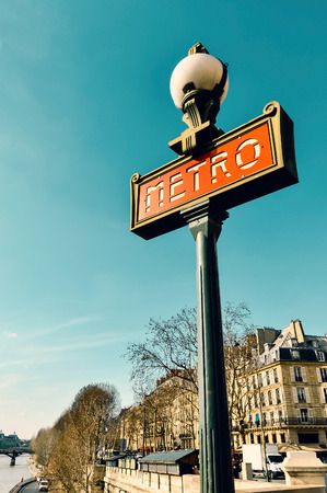 grading: Metro sign in Paris, France. Teal and orange color grading.