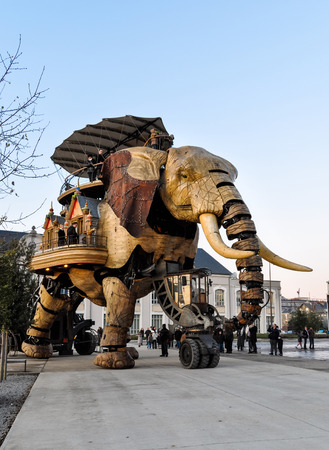 NANTES, FRANCE - CIRCA DECEMBER 2009: The Great Elephant goes for a walk with passengers aboard. Editorial
