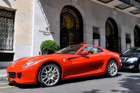 four wheel drive: PARIS, FRANCE - CIRCA JULY 2009: A Ferrari 599 GTB Fiorano parked in front of the George V Hotel in Paris