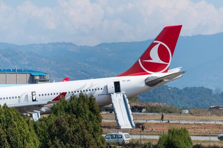 apparently: KATHMANDU, NEPAL - MARCH 4, 2015: Turkish Airlines flight THY726 crashed earlier in the morning at Tribhuvan International Airport apparently due to dense fog. No passengers were seriously hurt. Editorial