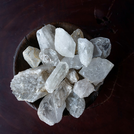 energising: Crystals in a wooden bowl Stock Photo
