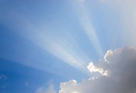 sunrays: Sunrays passing through clouds and blue sky
