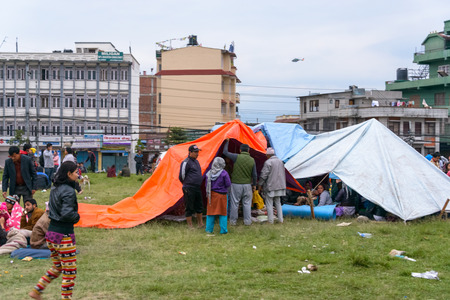 richter: KATHMANDU, NEPAL - APRIL 25, 2015: People gather on an open ground at Chuchepati just after the 7.8 earthquake hit Kathmandu Editorial