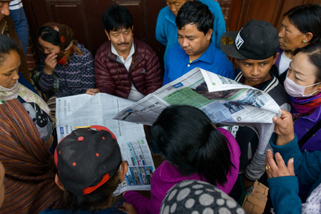 magnitude: KATHMANDU, NEPAL - APRIL 26, 2015: People try to get news from the papers after the 7.8 earthquake hit Nepal on 25 April 2015.