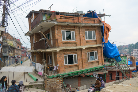 quake: KATHMANDU, NEPAL - APRIL 26, 2015: Partially collapsed house after the 7.8 earthquake hit Nepal on 25 April 2015.