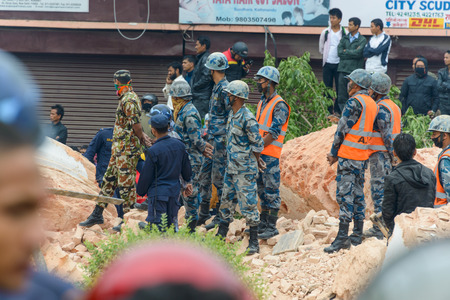 major force: KATHMANDU, NEPAL - APRIL 26, 2015: Nepal Armed Police Force, army and police start rescue efforts at the collapsed Dharhara tower after the major earthquake on 25 April 2015.