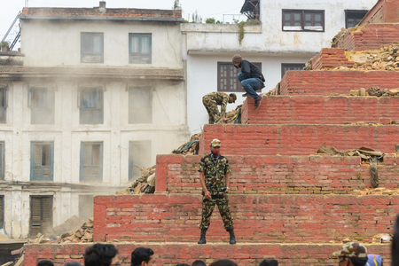 quake: KATHMANDU, NEPAL - APRIL 26, 2015: Military forces starts the rescue effort at Durbar Square which is severly damaged after the major earthquake on 25 April 2015.