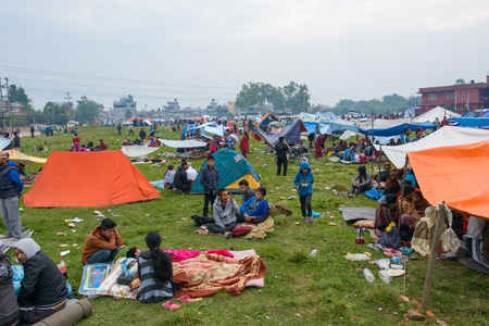 richter: KATHMANDU, NEPAL - APRIL 26, 2015: People stay on an open ground at Chuchepati after their first night outside after the 7.8 earthquake on 25 April 2015.