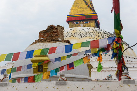 bodnath: KATHMANDU, NEPAL - APRIL 26, 2015: Minor damage at Boudhanath stupa after the 7.8 earthquake hit Nepal on 25 April 2015.