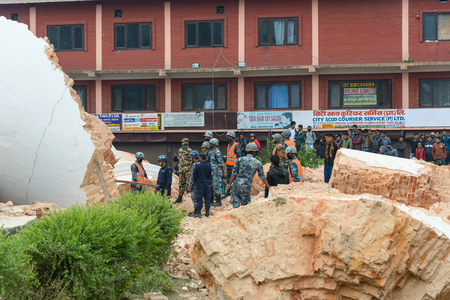 efforts: KATHMANDU, NEPAL - APRIL 26, 2015: Nepal Armed Police Force, army and police start rescue efforts at the collapsed Dharhara tower after the major earthquake on 25 April 2015.