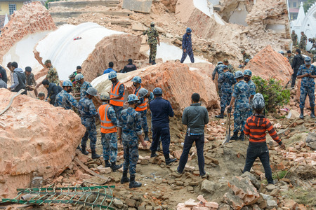 major force: KATHMANDU, NEPAL - APRIL 26, 2015: Nepal Armed Police Force, army, police and civilians start rescue efforts at the collapsed Dharhara tower after the major earthquake on 25 April 2015.