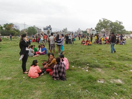 quake: KATHMANDU, NEPAL - APRIL 25, 2015: People gather on an open ground at Chuchepati just after the 7.8 earthquake hit Kathmandu Editorial