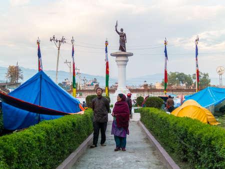 sherpa: KATHMANDU, NEPAL - APRIL 29, 2015: Makeshift campsite around Pasang Lhamu Sherpa statue in Chuchepati area (north east of Kathmandu) Editorial