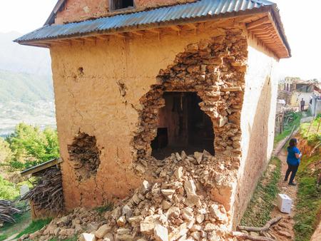 damaged house: KOT DANDA, LALITPUR, NEPAL - MAY 2, 2015: Damaged house after the 7.8 earthquake that hit Nepal on April 25, 2015.
