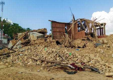 richter: KOT DANDA, LALITPUR, NEPAL - MAY 2, 2015: Damaged houses after the 7.8 earthquake that hit Nepal on April 25, 2015.
