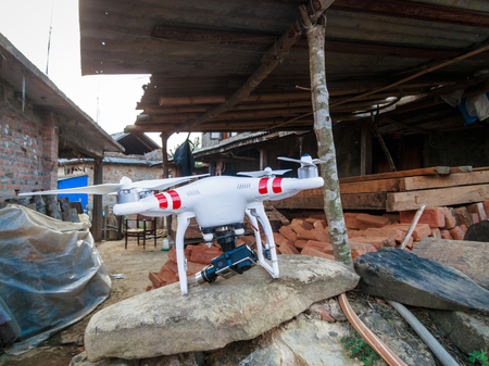 dada: KOTDANDA, NEPAL - MAY 2, 2015: A DJI Phantom 2 with a GoPro Hero3+ is used to assess the damages in the village.