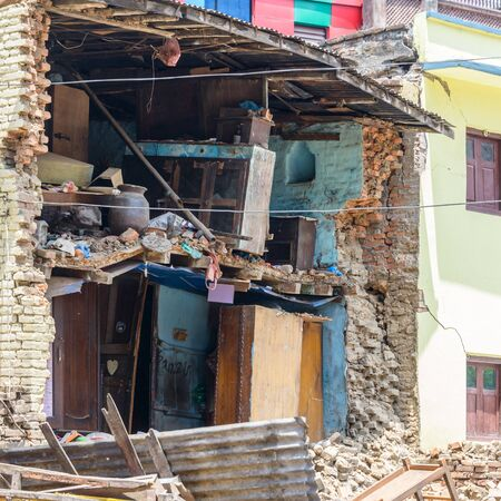 12 13: KATHMANDU, NEPAL - MAY 13, 2015: A damaged house after a 7.3 earthquake hit Nepal on May 12, 2015. Editorial